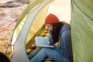 Woman With Book In Tent