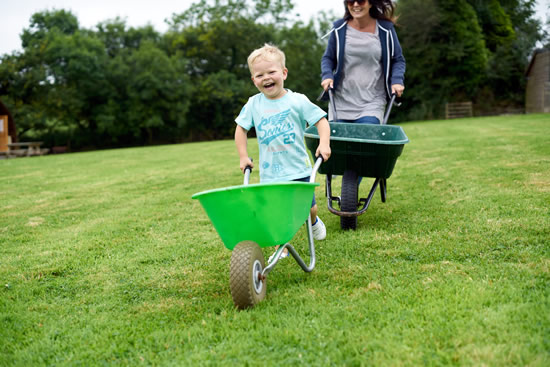 Penbugle Farm has a colourful fleet of wheelbarrows to help you transport everything to your Wigwam®